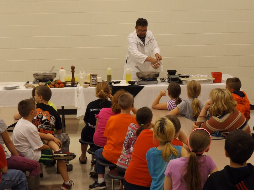 Chef Alfonso Contrisciani demonstrates to the third grade class at Junction City Elementary School how to make a delicious and healthy meal using fresh vegetables.  Demonstrations were held at three participating schools in Perry County as part of the Veggie U program in 2015.